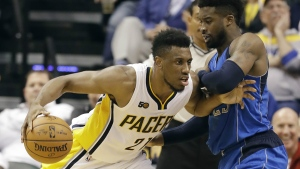 Indiana Pacers' Thaddeus Young goes to the basket against Dallas Mavericks' Wesley Matthews during the first half of an NBA basketball game in Indianapolis on Wednesday, Oct. 26, 2016. (AP / Darron Cummings)
