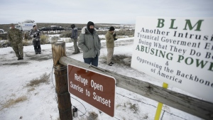Members of the group occupying the Malheur National Wildlife Refuge headquarters stand guard near Burns, Ore. on Monday, Jan. 4, 2016. (AP / Rick Bowmer)