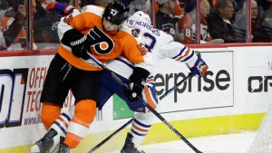 Edmonton Oilers' Matt Hendricks, right, kicks the puck away from Philadelphia Flyers' Shayne Gostisbehere during the first period of an NHL hockey game, Thursday, Dec. 8, 2016, in Philadelphia. (Matt Slocum/AP Photo)