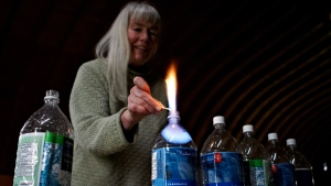 Jessica Ernst, a 54-year-old oil patch consultant, burns off methane in her well water in Rosebud, Alta., on June 2, 2011. (Jeff McIntosh / THE CANADIAN PRESS)