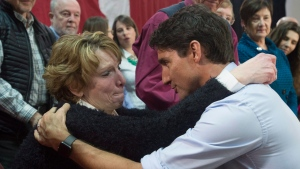 Prime Minister Justin Trudeau speaks with an emotional Kathy Katula, from Buckhorn, Ont. following a news conference in Peterborough, Ont. Friday Jan. 13, 2017. (Adrian Wyld/THE CANADIAN PRESS)
