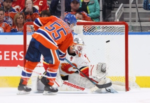 Calgary Flames goalie Brian Elliott (1) is scored on by Edmonton Oilers' Mark Letestu (55) in a shootout during NHL action in Edmonton, Alta., on Saturday January 14, 2017. THE CANADIAN PRESS/Jason Franson