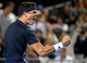 Canada's Milos Raonic celebrates after defeating France's Gilles Simon during their third round match at the Australian Open tennis championships in Melbourne, Australia, Saturday, Jan. 21, 2017. (AP / Aaron Favila)