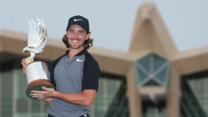 Tommy Fleetwood of England holds the trophy after he won the Abu Dhabi Golf Championship, in Abu Dhabi, United Arab Emirates, Sunday, Jan. 22, 2017. (AP Photo/Kamran Jebreili)
