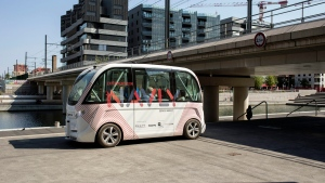 FILE- In this Sept. 9, 2016 file photo, the driverless electric free shuttle Navly drives through a district of Lyon, central France, as part of an experiment. Two electric-power EZ10 minibuses, which can carry up to six seated passengers, were put into service in Paris, on Monday, Jan. 23, 2017. (AP Photo/Laurent Cipriani, File)