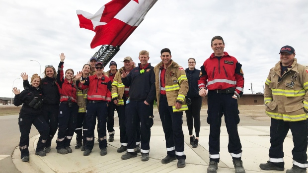 Firefighters welcome evacuees home