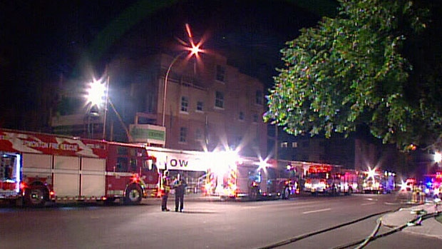 Fire investigators say a blaze at a south Edmonton apartment building that sent four to hospital early Sunday morning may have been deliberately set.