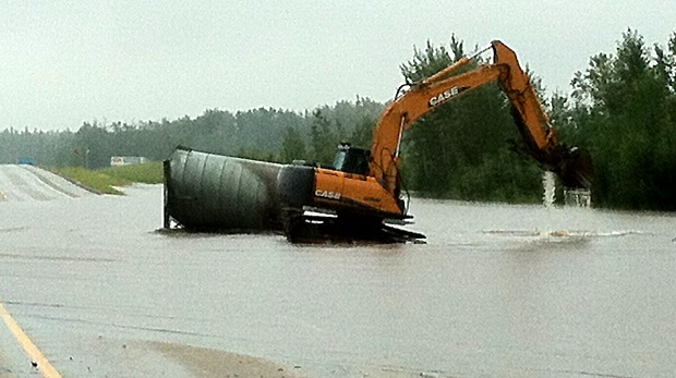Flooding on Highway 16 near Edmonton continues to cause problems a day after a displaced culvert caused flooding on the major highway leading in and out of Edmonton.