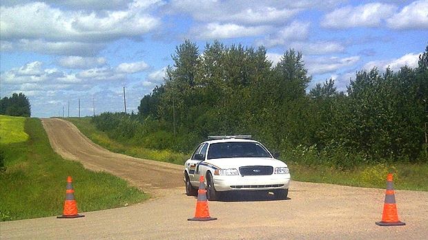 An RCMP cruiser blocks access to an area near Vegreville, Alta. after a fatal shooting involving officers killed a 43-year-old man. The Alberta Serious Incident Response Team is investigating the shooting.