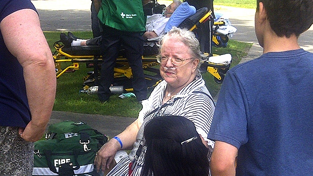 A number of evacuated residents of the Canora Gardens senior's residence were treated by EMS on the front lawn of the building on Tuesday, July 31.