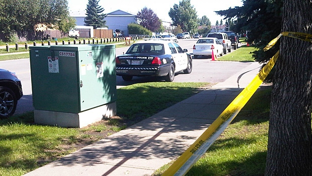 Homicide detectives are at the scene of a Mill Woods townhouse complex Monday.