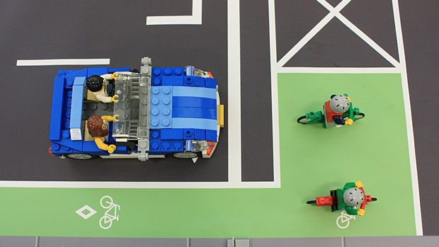 A city illustration showing how the new 'bike box' will work. Cyclists can move into a large, green-painted square at the intersection as a way to be more visible to motorists. SUPPLIED.