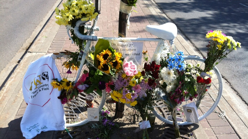 A day after the 'ghost bike' was placed, flowers and notes adorned the memorial for Isaak Kornelsen on Tuesday, August 28.