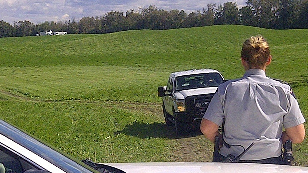 RCMP on the scene of a serious incident near Leduc on Tuesday, September 4, 2012.