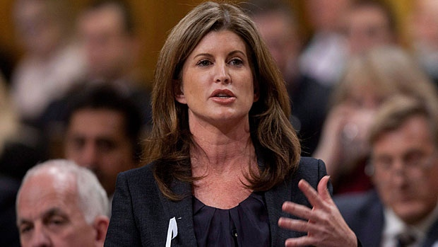 Minister for the Status of Women Rona Ambrose responds to a question during Question Period in the House of Commons in Otawa Tuesday December 6, 2011. THE CANADIAN PRESS/Adrian Wyld.
